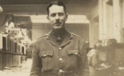 A man in First World War army uniform in a bank office