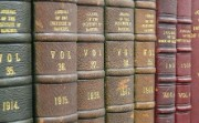 A row of 1910s journals on a shelf