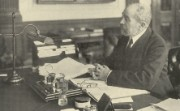 Sir Felix Schuster at his desk, 1930s